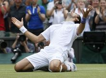 Serbia's Novak Djokovic celebrates after defeating France's Jo-Wilfried Tsonga in their men's semifinal at the All England Lawn Tennis Championships at Wimbledon on Friday. Djokovic advanced to his first Wimbledon final and locked up the No. 1 ranking. (AP Photo/Alastair Grant)