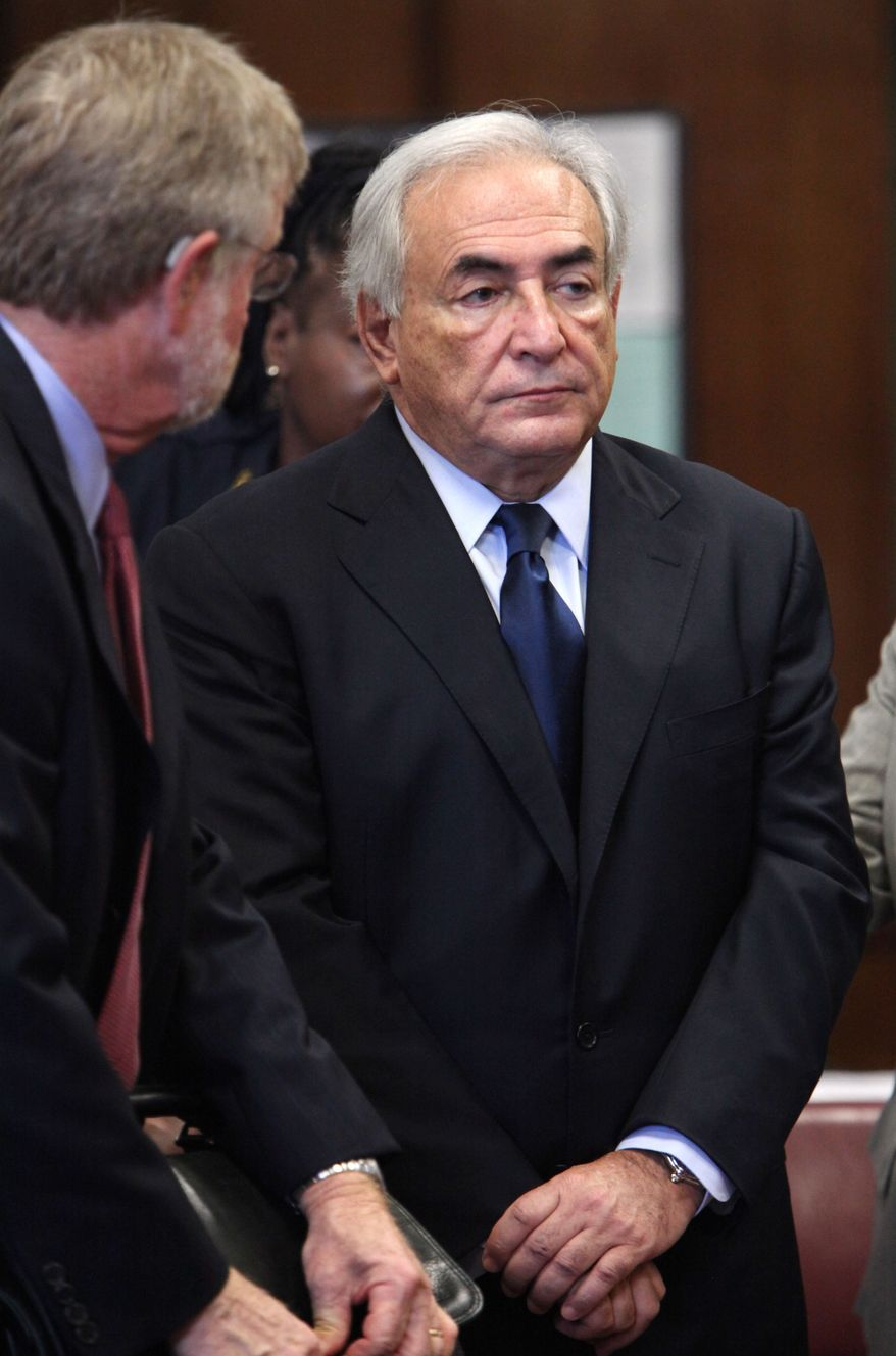 ** FILE ** In this Monday, June 6, 2011, file photo, former IMF leader Dominique Strauss-Kahn, right, appears at his arraignment on charges of sexually assaulting a Manhattan hotel maid, at State Supreme Court in New York.  (AP Photo/Allan Tannenbaum, Pool, File)