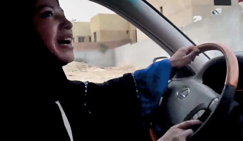 In this image made from video released by Change.org, a Saudi Arabian woman drives a car on June 17, 2011, as part of a campaign to defy Saudi Arabia's ban on women driving, in Riyadh, Saudi Arabia. (Associated Press)
