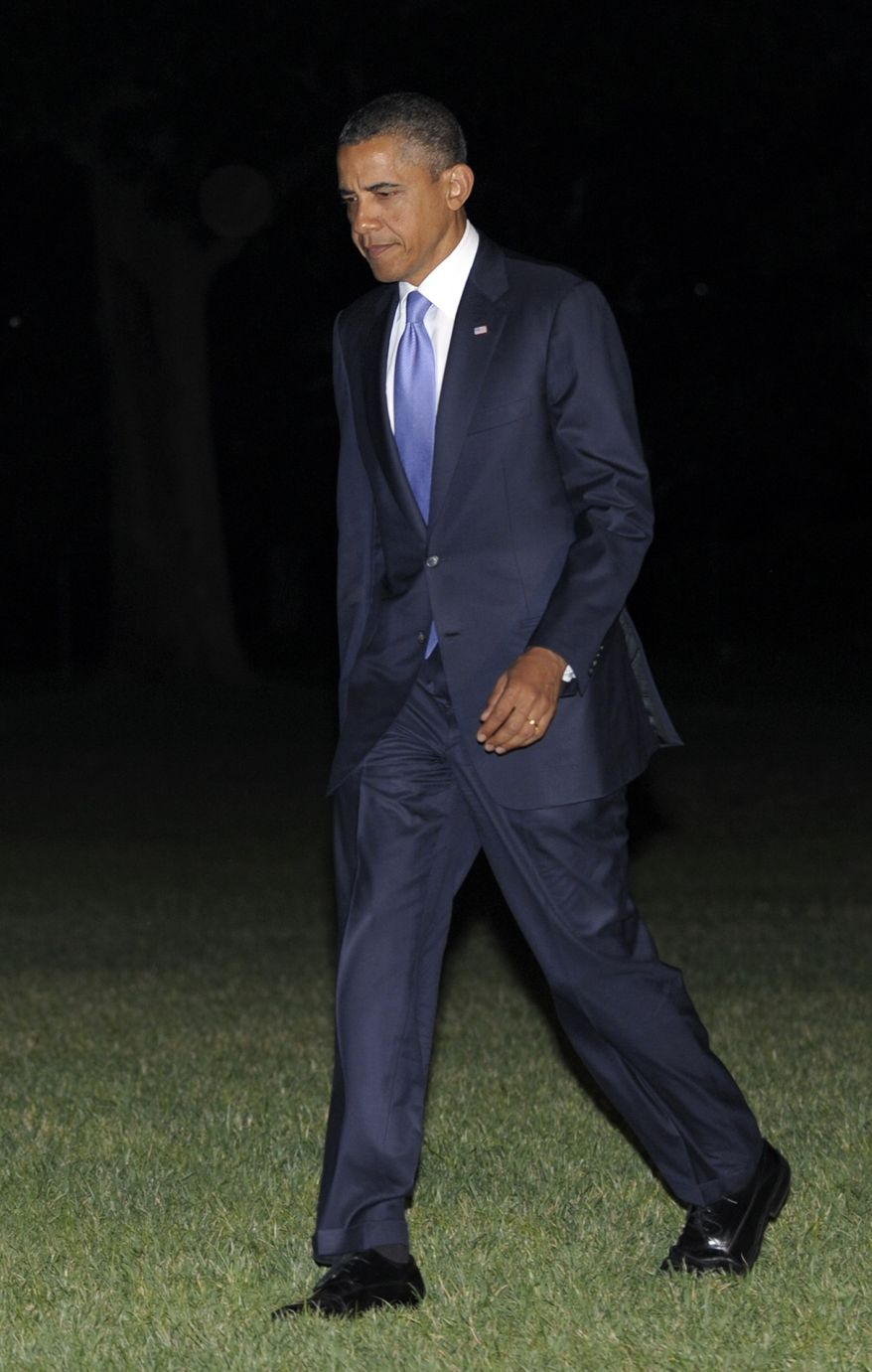 President Barack Obama walks off of Marine One on the South Lawn of the White House in Washington, Thursday, June 30, 2011, after returning from fundraising in Philadelphia. (AP Photo/Susan Walsh)