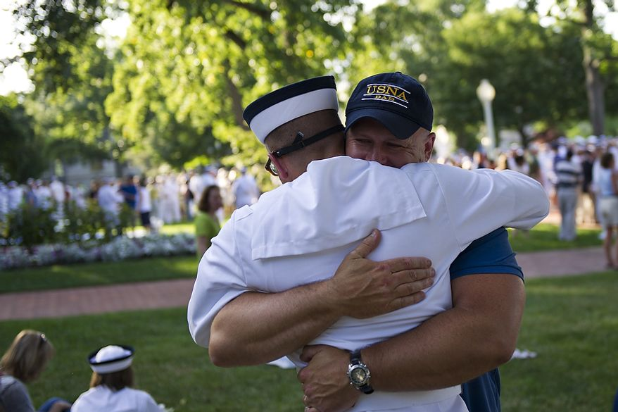 Naval Academy Plebe Brandon Hudson gets a hug from his father Brad Hudson after during the Oath of Office Ceremony, on Induction Day at the U.S. Naval Academy, in Annapolis, Md., Thursday, June 30, 2011. Induction Day marks the day the young men and women begin their transformation from civilians to midshipmen and begin their Plebe Summer training program. (Drew Angerer/The Washington Times)