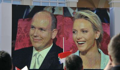 Charlene Wittstock and Prince Albert II of Monaco are seen on a giant screen outside the Monaco palace, Friday, July 1, 2011, during their civil wedding marriage ceremony. (AP Photo/Bruno Bebert, Pool)