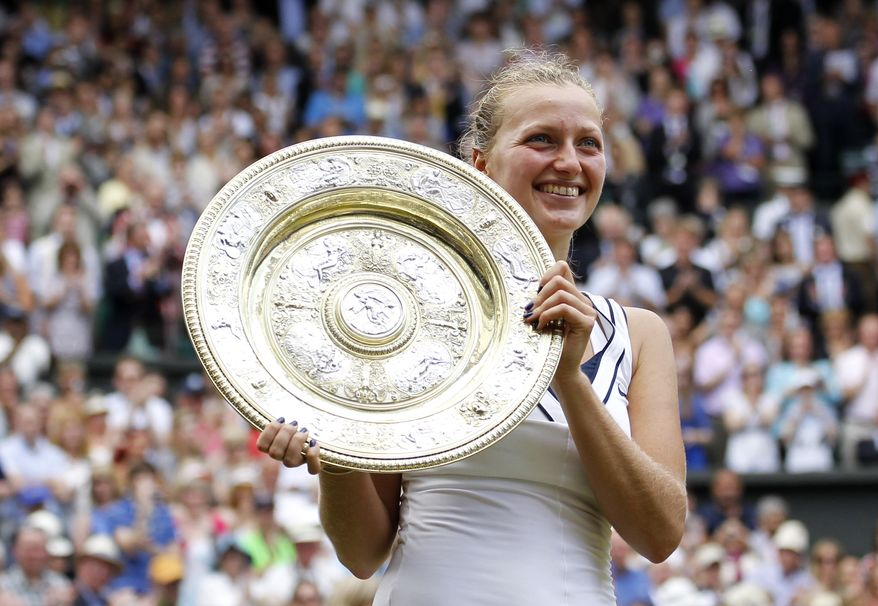 Petra Kvitova of the Czech Republic holds her trophy after defeating Russia's Maria Sharapova in the ladies' singles final at the All England Lawn Tennis Championships at Wimbledon, Saturday, July 2, 2011. (AP Photo/Anja Niedringhaus)