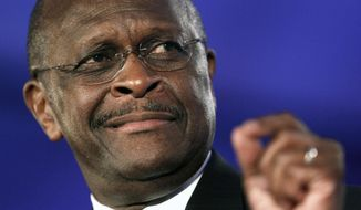 **FILE** Republican presidential hopeful Herman Cain (Associated Press)