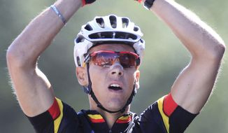 New overall leader Philippe Gilbert of Belgium celebrates winning the first stage of the Tour de France cycling race over 191,5 kilometers ( 119 miles) starting in Passage du Gois and finishing in Mont des Alouettes, les Herbiers, western France, Saturday July 2, 2011. (AP Photo/Laurent Rebours)
