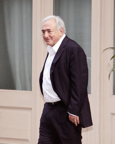 Dominique Strauss-Kahn, right, former head of the IMF, leaves his house for the first time after the judge changed the terms of his house a
