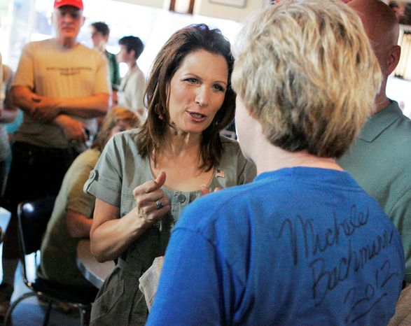 Republican presidential candidate Michele Bachmann (left) speaks with Sheila Reiland of Iowa City, Iowa, during a breakfast chat at the Bluebird Diner on Saturday in Iowa City. The event kicked off Bachmann's Iowa Bus Tour. (Associated Press)