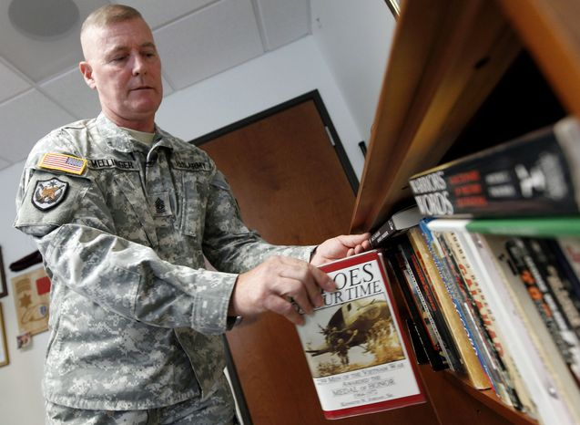 Army Command Sgt. Maj. Jeff Mellinger, 58, is believed to be the last conscripted soldier to have served continuously without a break. He is set to retire this summer. (AP Photo/Alex Brandon)