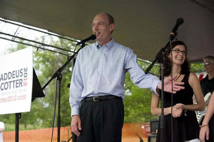 Rep. Thaddeus McCotter, Michigan Republican, jokes with a crowd of about 150 supporters at the WAAM Freedom Fest in Whitmore Lake, Mich., on Saturday, July 2, 2011, where Mr. McCotter announced his candidacy for president. Mr. McCotter's wife, Rita, and two of his children, Timothy and Emilia, joined him onstage. (AP Photo/Lon Horwedel)