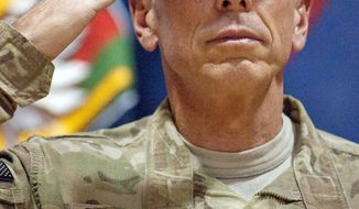Gen. David H. Petraeus prepares to administer the oath of re-enlistment to 235 U.S. service members during a ceremony in Kandahar, Afghanistan, on Monday. (Associated Press)