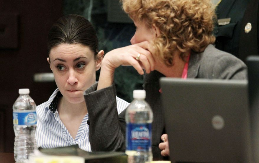 ASSOCIATED PRESS PHOTOGRAPHS Casey Anthony (left) listens with her attorney, Dorothy Clay Sims, on Monday, the final day of arguments during her murder trial in Orlando, Fla. Miss Anthony is facing seven total charges in the 2008 death of her 2-year-old daughter Caylee.