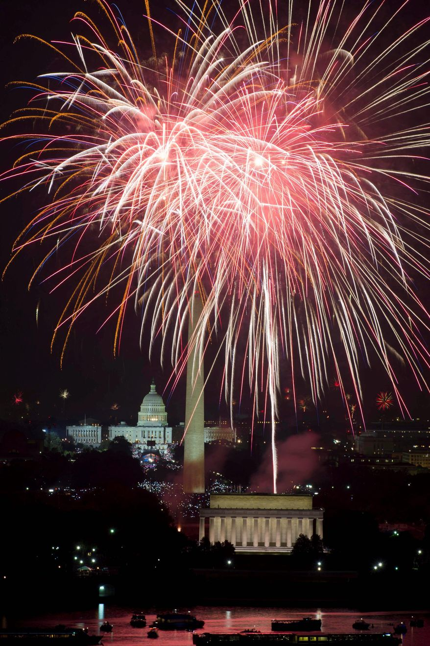 PYROTECHNICS: Fourth of July fireworks light up the sky over the National Mall on Monday night, to the delight of tens of thousands of rapt spectators. (Drew Angerer/The Washington Times)