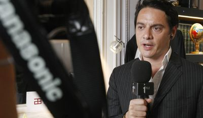 David Koubbi, a lawyer for French novelist Tristane Banon, addresses reporters at his office in Paris on Monday, July 4, 2011. Ms. Banon will file a criminal complaint Tuesday accusing Dominique Strauss-Kahn of attempted rape, Mr. Koubbi said. (AP Photo/Remy de la Mauviniere)