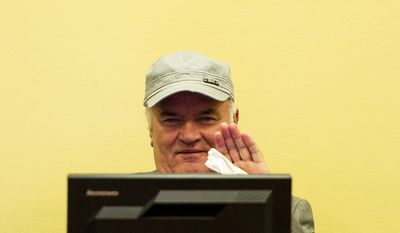 Former Bosnian Serb military chief Ratko Mladic waves in the courtroom during a hearing at the U.N.'s International Criminal Tribunal for the Former Yugoslavia in The Hague on Monday, July 4, 2011. (AP Photo/ Valerie Kuypers, Pool)
