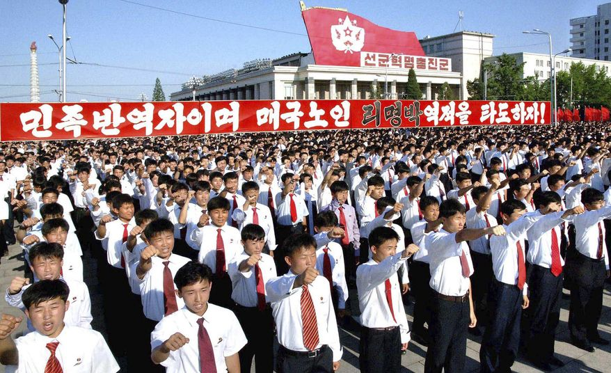 """North Koreans shout slogans during a massive rally in Kim Il-sung Square in Pyongyang, North Korea, on Monday, July 4, 2011, to denounce the conservative government of South Korean President Lee Myung-bak as a """"group of unparalleled traitors."""" (AP Photo/Korean Central News Agency via Korea News Service)"""