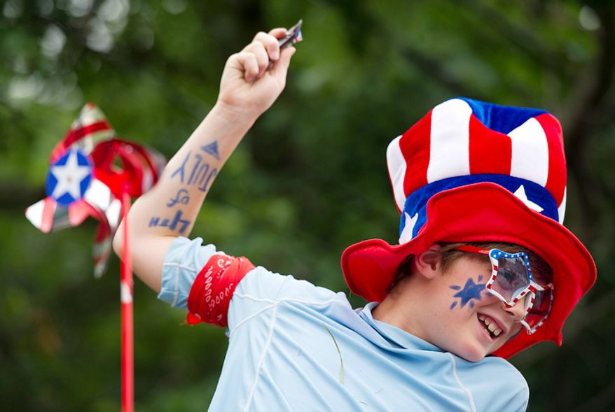 Jack Campanella, 9, of Chevy Chase, Md., rides atop a float during the 45th annual Palisades July Fourth parade in Washington. (Barbara L. Salisbury/The Washington Times)