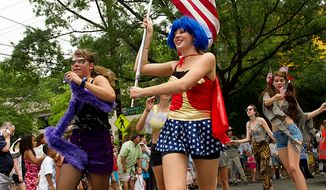 The Palisades Pop Stars, including Lily Shafroth (center), 18, of Washington, dance their way down MacArthur Boulevard Northwest in Washington on Monday, July 4, 2011, as part of the Palisades July Fourth parade. The girls decided it would be fun to march, so they donned costumes and called themselves the Pop Stars. (Barbara L. Salisbury/The Washington Times)