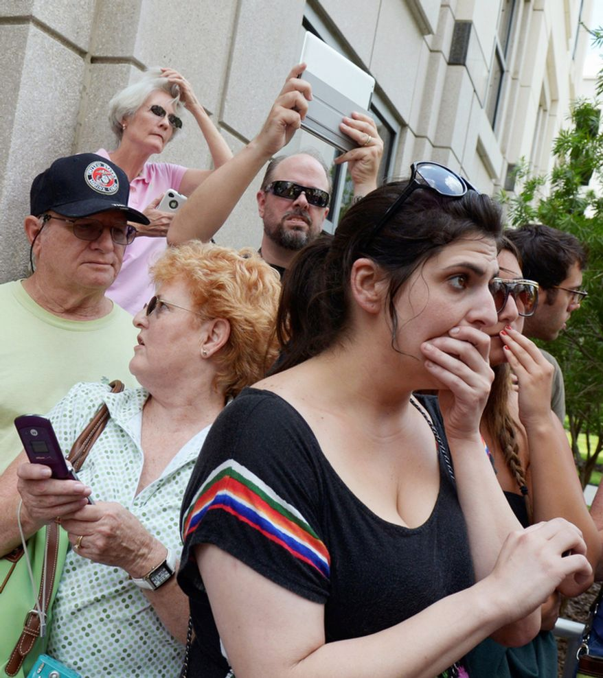 Jenn Keller, right, reacts after Casey Anthony's not-guilty verdict was announced outside the Orange County Courthouse.  (AP Photo/Phelan M. Ebenhack)