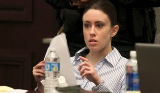 Casey Anthony goes over paperwork during a break on the final day of arguments in her murder trial at the Orange County Courthouse in Orlando, Fla., on July 4, 2011. Anthony has plead not guilty to first-degree murder in the death of her daughter, Caylee, and could face the death penalty if convicted of that charge. (Associated Press)