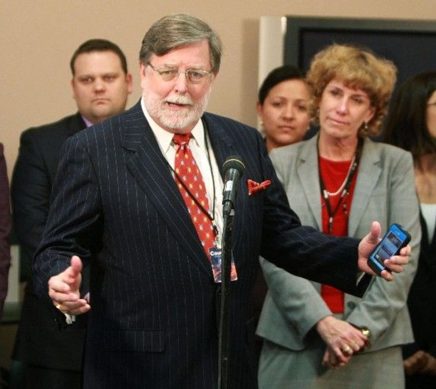 Associated Press photographs Defense lawyer Cheney Mason answers questions Tuesday after his client, Casey Anthony, was found not guilty in her murder trial in Orlando, Fla. Ms. Anthony had been charged with killing her 2-year-old daughter, Caylee. Mr. Mason assailed cable news coverage of the trial.