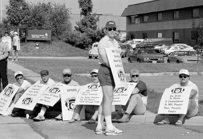 ASSOCIATED PRESS PHOTOGRAPHS Jay Schroeder and a host of Redskins teammates wore sandwich board strike signs outside the team's training facility Sept. 22, 1987. When running back Wayne Wilson (above right) and other replacement players took the field, Washington went 3-0 -