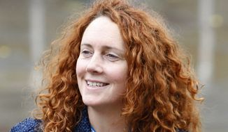 ** FILE ** Rebekah Brooks, chief executive of News International, which is part of Rupert Murdoch's News Corp. media empire, arrives at the Conservative Party conference in Manchester, England, in October 2009. (AP Photo/Jon Super, File)