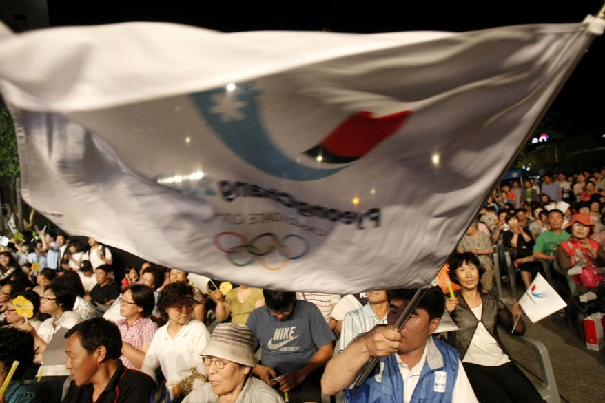 South Koreans gather in Chuncehon, South Korea, on Wednesday, July 6, 2011, to await the announcement by  the International Olympic Committee of the site of the 2018 Winter Olympics. Pyeongchang, South Korea, beat out Munich and Annecy, France, for the games. (AP Photo/Ahn Young-joon)
