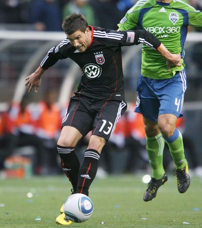 D.C. United's Chris Pontius pushes aside Seattle Sounders defender Patrick Ianni en route to scoring his second goal of the night during an MLS soccer game Thursday, June 10, 2010, in Seattle. (AP Photo/The Olympian, Tony Overman)