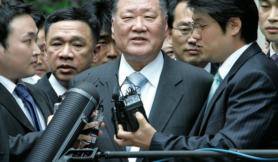 """Among the South Korean executives who have be involved in corrupt business practices are Hyundai Motor Chairman Chung Mong-Koo (center). Mr. Chung was found guilty of embezzlement, but a court suspended his sentence because he was deemed """"too important to serve time."""" (Associated Press)"""