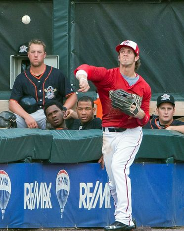 In this July 4, 2011 photo, Harrisburg Senators' Bryce Harper throws from the corner of left field during the third inning of a baseball game against the Erie SeaWolves at Metro Bank Park, in Harrisburg, Pa. Harper's impressive stats earned the teenager a Fourth of July promotion Monday, moving on to Double-A as part of the Washington Nationals' measured approach with last year's No. 1 overall draft pick. (AP Photo/The Patriot-News, Andy Colwell)