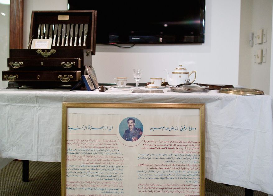 More than 200 artifacts were returned to the government of Iraq during a repatriation ceremony Thursday at the Iraqi Cultural Center in Washington. Federal investigations turned up silverware and a teapot from the Saddam Hussein era, a 4,000- to 5,000-year-old necklace and other cultural treasures that had been taken as mementos by U.S. troops and contractors. (Pratik Shah/The Washington Times)