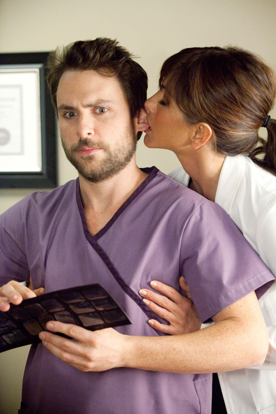 """In the new comedy """"Horrible Bosses,"""" Jennifer Aniston plays a sexually deviant dentist who harasses her assistant (Charlie Day). The film centers around three employees who hatch a plot to kill each other's bosses. (Warner Bros. Pictures via Associated Press)"""