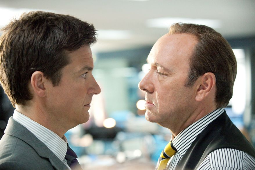 """The new comedy """"Horrible Bosses"""" features Kevin Spacey (right) as the sadistic employer of Jason Bateman's character. (Warner Bros. Pictures via Associated Press)"""