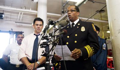 D.C. Fire Chief Kenneth Ellerbe (right) and Rich Marianos, with the ATF Bureau, announce the arrest and charging of Maurice Timothy Dews with several counts of arson. (Drew Angerer/The Washington Times)