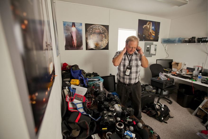 ANDREW S. GERACI/THE WASHINGTON TIMES Scott Andrews confers on the phone Monday as he prepares remote cameras to record the launch of Space Shuttle Atlantis at the Kennedy Space Center in Florida. He has dozens of cameras set up at every conceivable angle.
