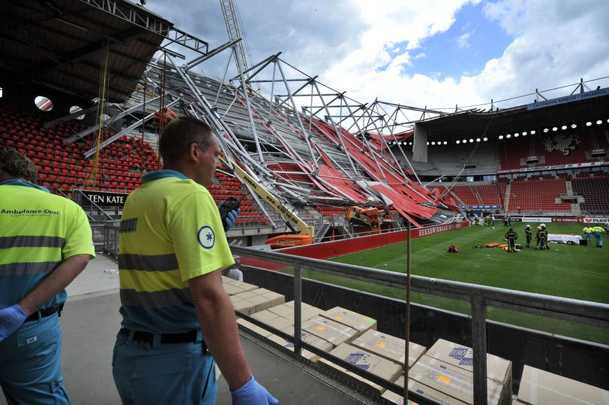 Ambulance workers are seen inside the Grolsch Veste stadium in Enschede, Netherlands, on July 7, 2011. A section of the football stadium collapsed during off-season construction work, trapping people underneath, police said. (Associated Press)