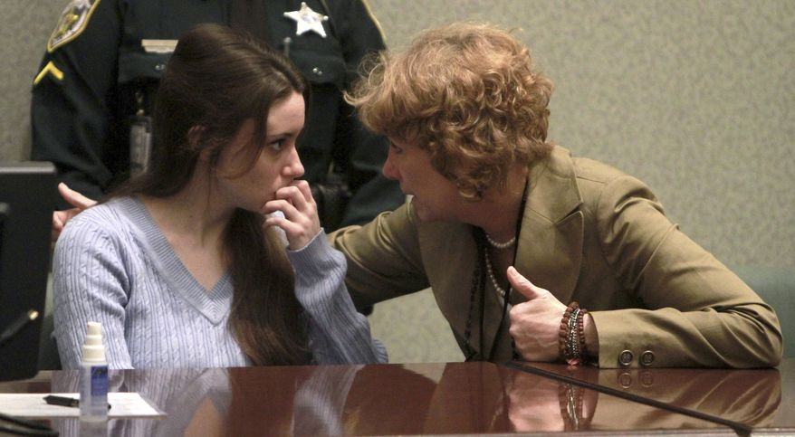 Casey Anthony (left) talks with her lawyer Dorothy Clay Sims before a sentencing hearing in Orlando, Fla., on Thursday, July 7, 2011. (AP Photo/Joe Burbank, Pool)
