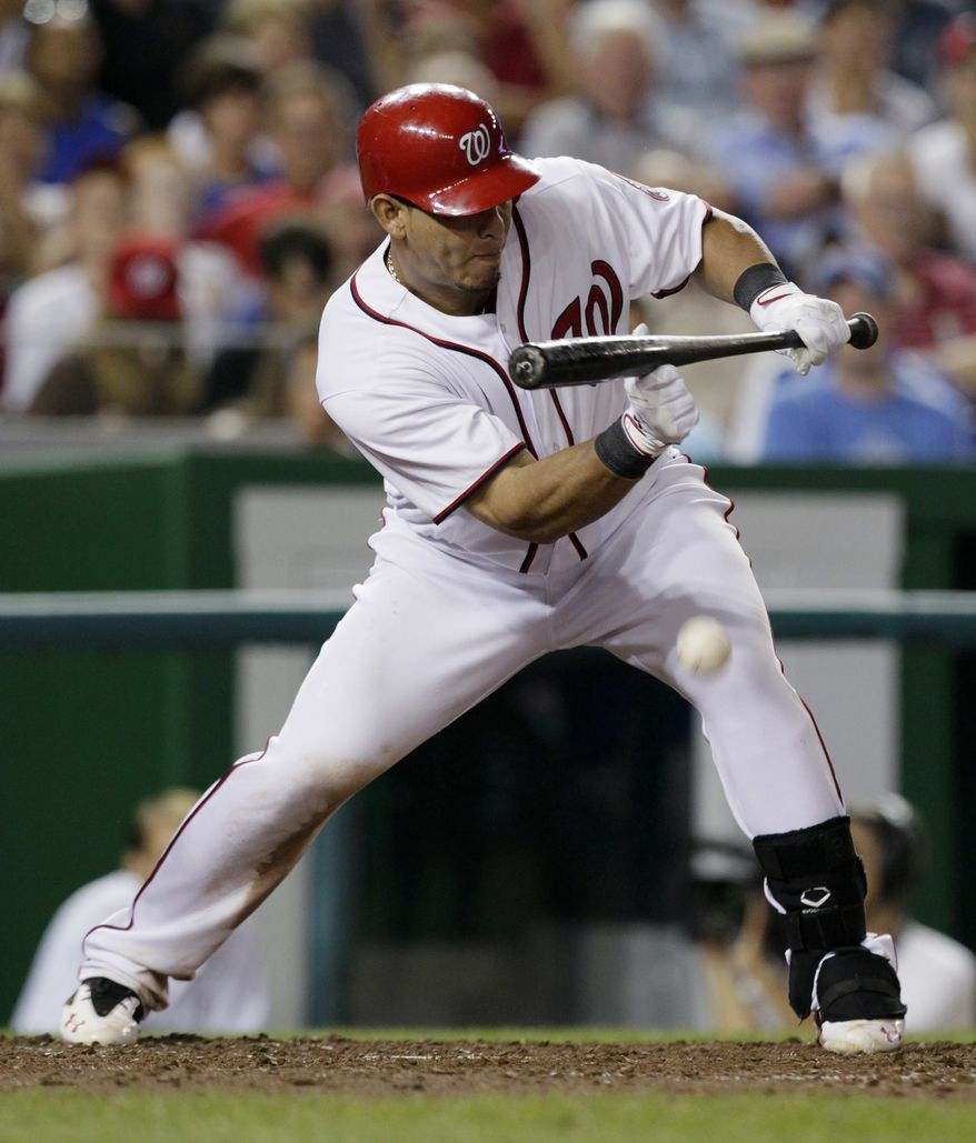 Washington Nationals' Wilson Ramos hits a sacrifice bunt to drive in Washington Nationals' Michael Morse for the ultimate winning run in the seventh inning against the Chicago Cubs at Nationals Park on Wednesday. The Nationals won 5-4. (AP Photo/Carolyn Kaster)