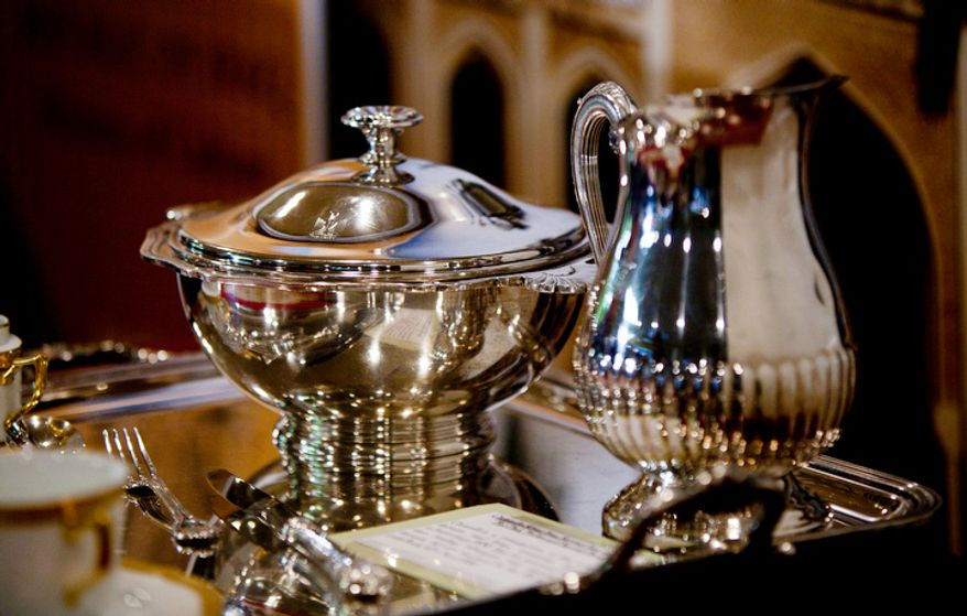 Silverware is displayed during a repatriation ceremony of Iraqi antiquities at the Iraqi Cultural Center. (Pratik Shah/The Washington Times)