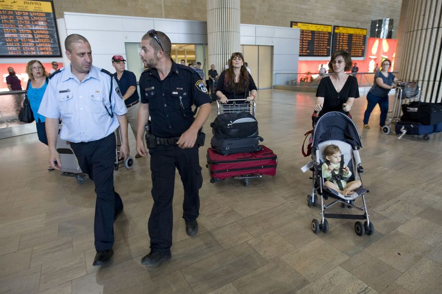 The Israeli police force has a presence in the arrival hall at Ben-Gurion International Airport near Tel Aviv on Wednesday, July 6, 2011. (AP Photo/Ariel Schalit)