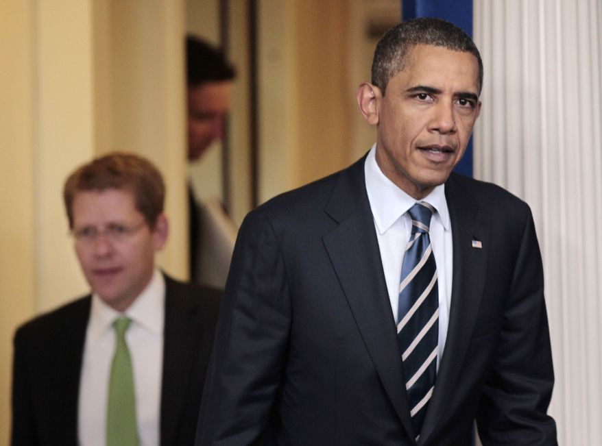 President Obama, followed by White House press secretary Jay Carney, arrives at the press briefing room of the White House in Washington on Thursday, July 7, 2011, to talk about the ongoing budget negotiations. (AP Photo/Pablo Martinez Monsivais)