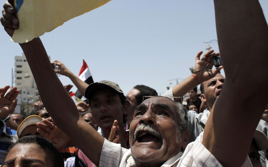 """An elderly Egyptian protester chants anti-military ruling council prayers during a demonstration on July 8, 2011, following the Muslims' weekly Friday prayers, part of nationally organized protests called """"The revolution first"""" at the main Arba'in square in Suez, Egypt. (Associated Press)"""