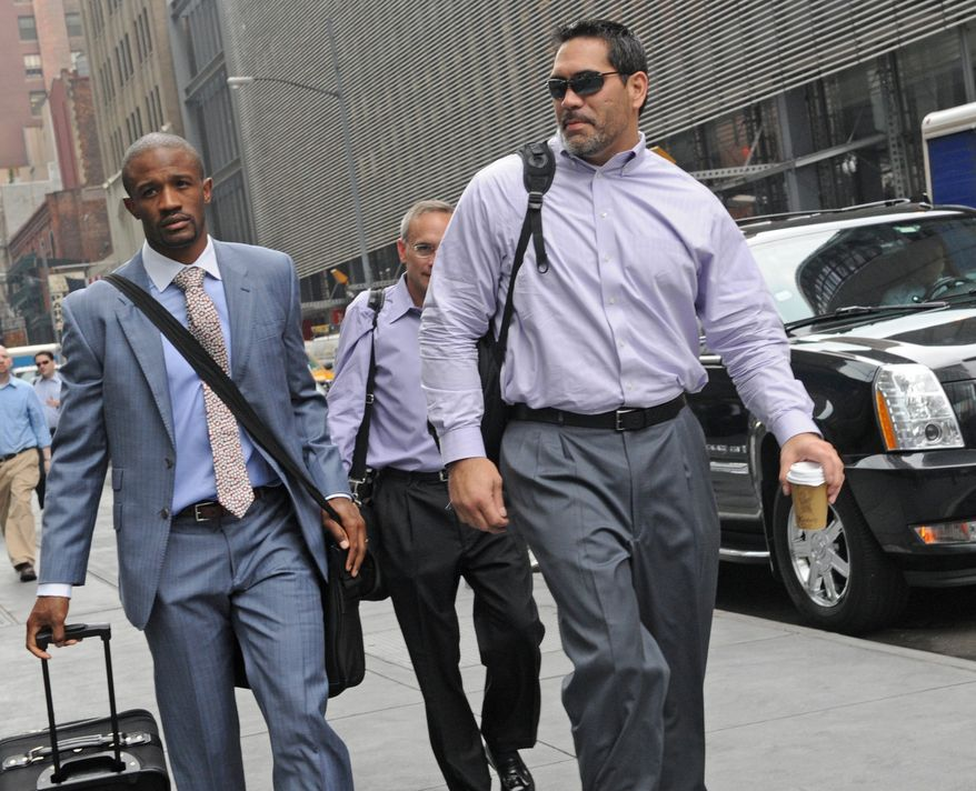 Former Tennessee Titans center and NFL Players Association President Kevin Mowae, right, enters a Manhattan law office, Friday, July 8, 2011, in New York. Members of the NFL Players' Association executive board and owners are meeting in hopes of resolving a lockout that began in March. (AP Photo/ Louis Lanzano)