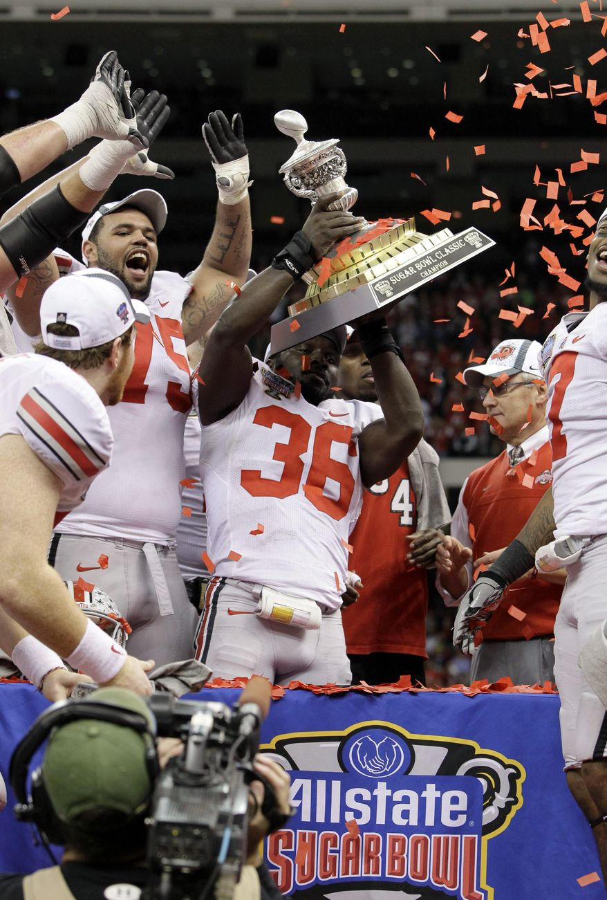**FILE** This photo from Jan. 4, 2011, shows Ohio State linebacker Brian Rolle (36) holding up the Sugar Bowl trophy after Ohio State beat Arkansas 31-26 in the Sugar Bowl at the Louisiana Superdome in New Orleans. (Associated Press)