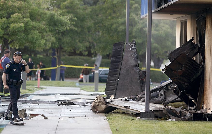 The wreckage of a small plane sticks out of the side of an unoccupied office building at Watsonville Community Hospital on July 7, 2011, in Watsonville, Calif. The plane had just taken off from the Watsonville Municipal Airport. Two people were killed in the crash. (Associated Press/The Sentinel)