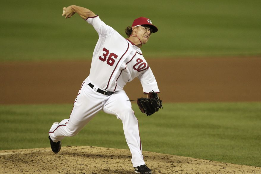 Washington Nationals relief pitcher Tyler Clippard (36) throws against the Colorado Rockies during the seventh inning of a baseball game at Nationals Park, Friday, July 8, 2011, in Washington. The Rockies won 3-2. (AP Photo/Jacquelyn Martin