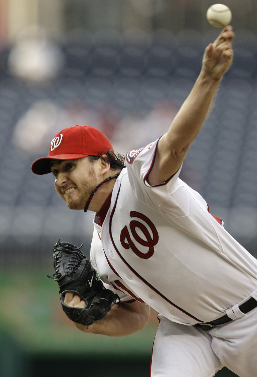Washington Nationals starter John Lannan was struck in the face by a line drive off the bat of the Colorado Rockies' Ty Wigginton in the Nats' 3-2 loss. Immediate X-rays came back negative and Lannan was diagnosed with a nasal contusion. He was sent to the hospital for further evaluation. (AP Photo/Jacquelyn Martin)