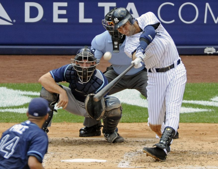 New York Yankees' Derek Jeter hits a home run for his 3,000th career hit during the third inning of a baseball game against the Tampa Bay Rays, Saturday, July 9, 2011, at Yankee Stadium in New York. Rays catcher John Jaso, pitcher David Price, left, and umpire Jim Wolf look on. Jeter became the 28th major leaguer to hit the milestone and also the first Yankees player. (AP Photo/Bill Kostroun)