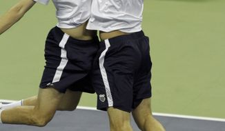 United States' Bob Bryan, left, and doubles partner Mike Bryan celebrate after beating Spain's Fernando Verdasco and Marcel Granollers 6-7, 6-4, 6-4, 6-4 at the Davis Cup quarterfinal tennis match, Saturday, July 9, 2011, in Austin, Texas. (AP Photo/Kim Johnson Flodin)