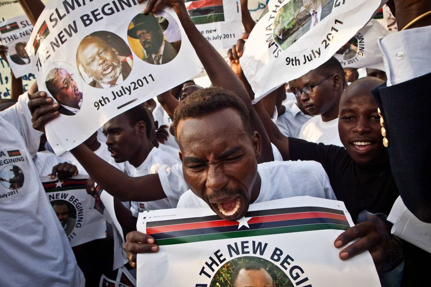 A crowd of men scream in celebration during the independence ceremony of the Republic of South Sudan in Juba, South Sudan, on Saturday July 9, 2011. South Sudan officially became the 193rd country in the world on Saturday, after voting to secede from Sudan in January, 2011. (AP Photo/Andrew Burton)